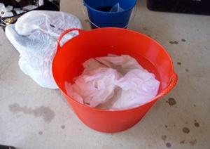 Soaking the fabric in Soda Ash water