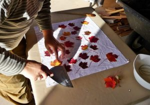 Applying leaves to prepared fabric