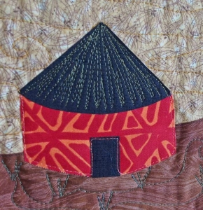 Closeup of a quilted village house