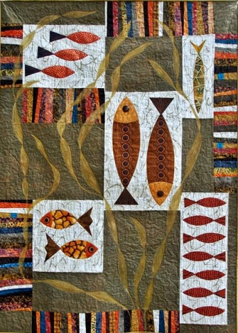 Fish and Chips quilt in alternate colorway finished with Shiva paint sticks