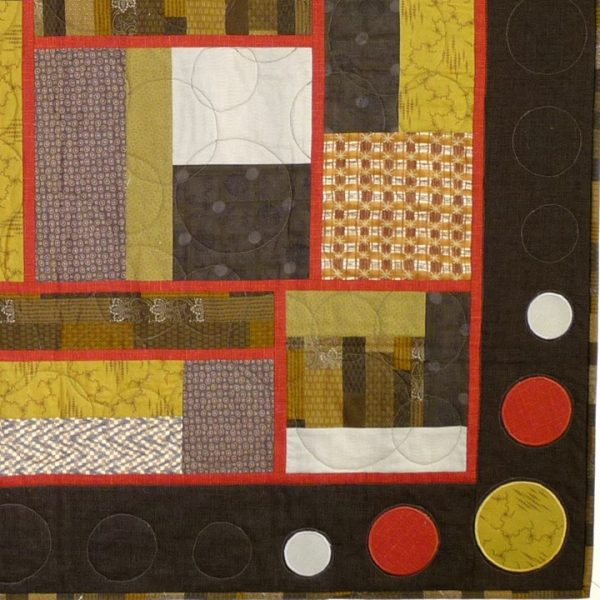 Embellishments provided by appliqué and quilted circles