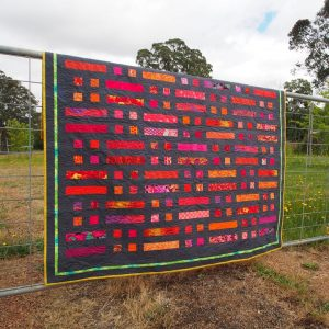 Bushfire quilt is well suited to strong fabric colour choices