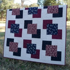 The owl blocks appear to float across the quilt