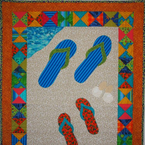 The sandals, shells and paw prints are appliqued