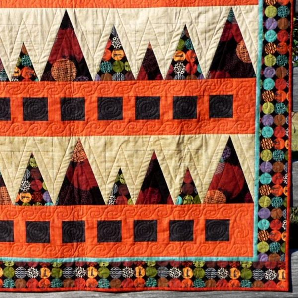 Closeup of Sawtooth Mountains quilt showing the detailed quilting