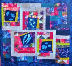 Quilt featuring ice-dyed fabric