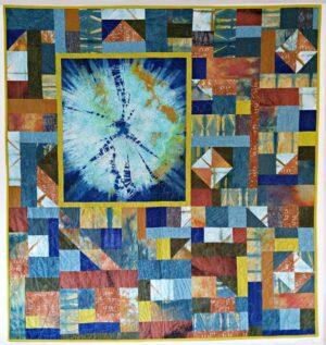 Finished indigo over ice-dye quilt